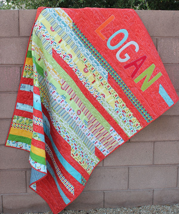 Appliqued Jelly Roll Race Quilt