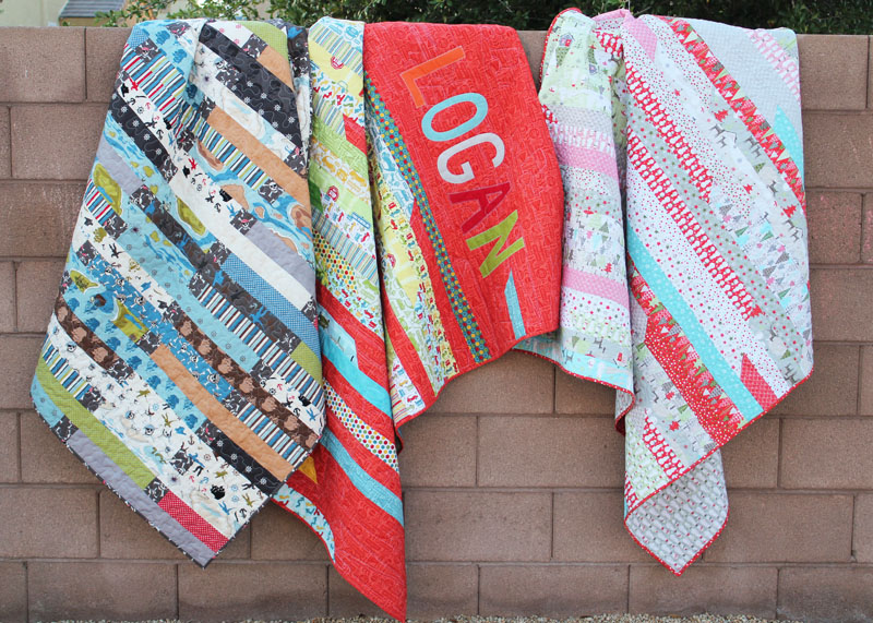 three jelly roll race quilts