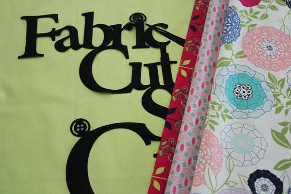 Auditioning fabrics for the wall hanging