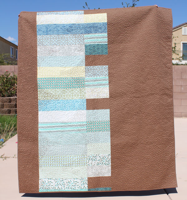 back of roots and wings quilt