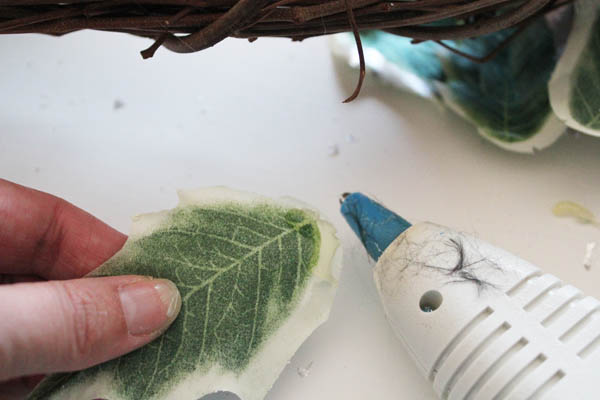 Hot glue on the back of leaves