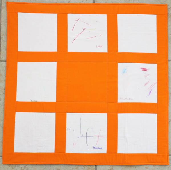 orange signature baby quilt