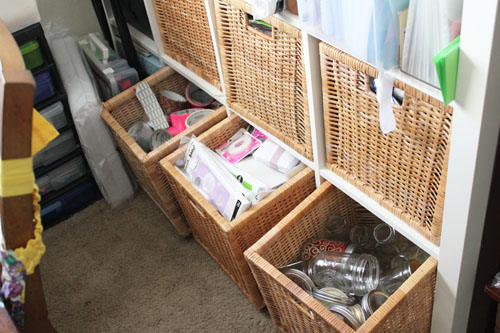 baskets in craft shelving unit