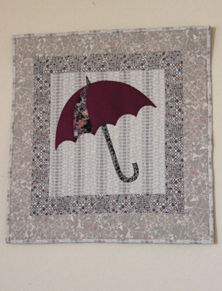 Umbrella applique wall hangning