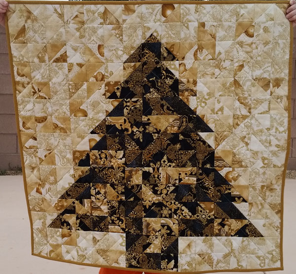 christmas tree quilt from half square triangles