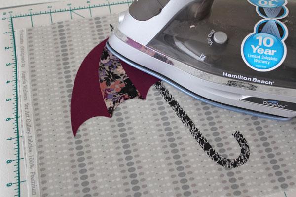 iron down applique umbrella