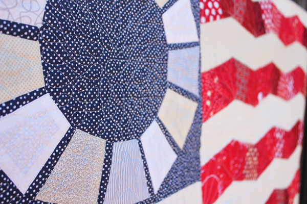 close up of Glory scrappy flag quilt