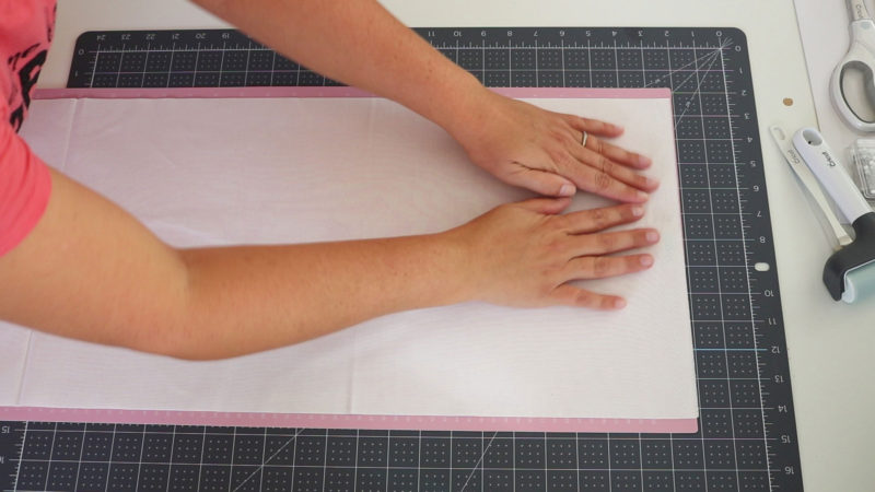 place fabric on mat