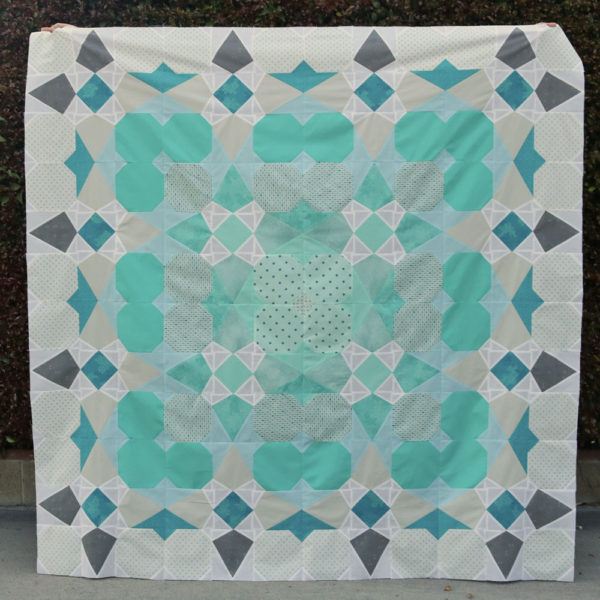 This image has an empty alt attribute; its file name is Envy-quilt-square-600x600.jpg