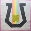 Horseshoe, rainbow, and clover quilt block